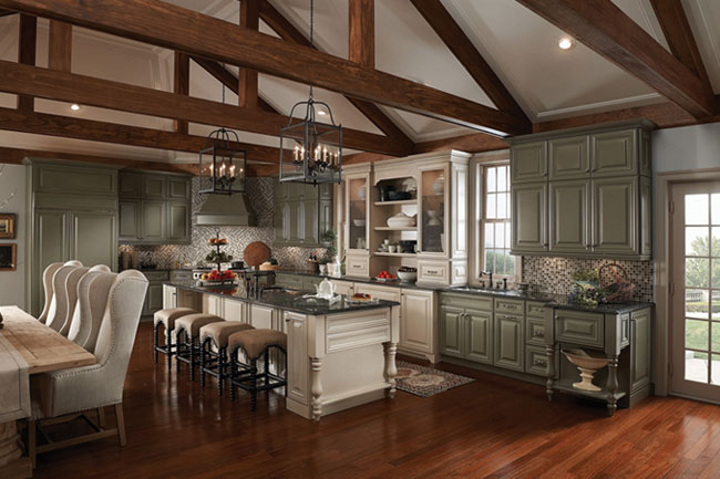 A pairing of painted finishes calls attention to the hutch displaying heirlooms and collectibles in this polished kitchen.