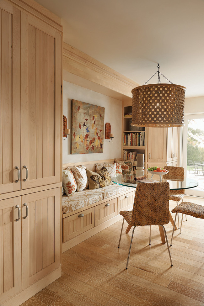 Tall beaded cabinets and drawers under the banquette continue the storage options and design aesthetic through the hip breakfast area.