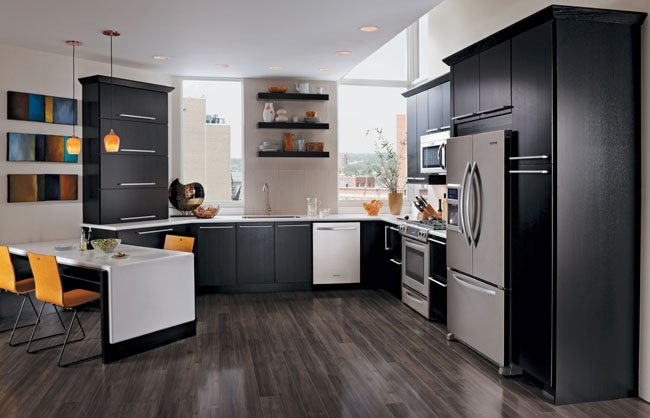 Bryant Oak Square Quartersawn Oak in Onyx is the anchor in this dynamic, contemporary kitchen, echoed by the bold horizontal drawer pulls and open shelves. Angular chairs, stainless appliances, and punches of color complete the look.