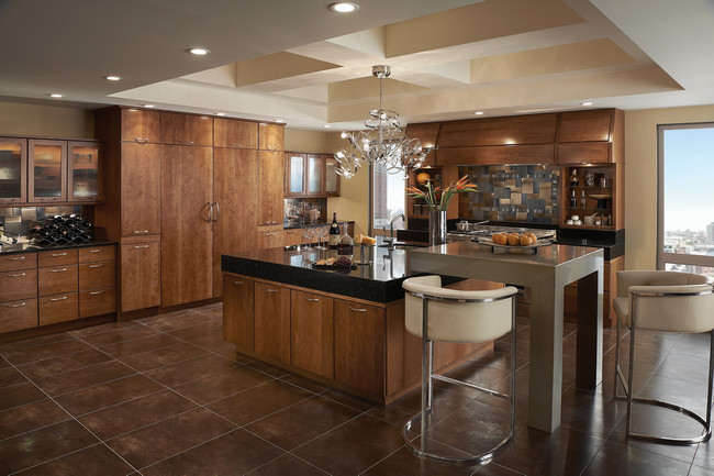 Floor-to-ceiling units streamline the kitchen and take the focus off the refrigerator, turning it instead on favorite serving pieces highlighted behind glass doors.
