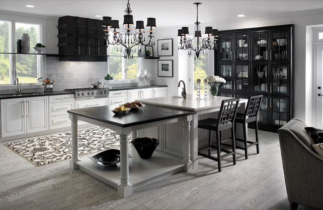 The dramatic contrast between Vintage Dove White and Vintage Onyx on Cherry creates a bold and unique kitchen and dining space.