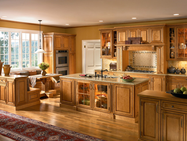 The raised panel cabinet doors and oil rubbed bronze hardware give this kitchen a refined grace, while the built-in breakfast nook and spacious island make it a comfortable spot to enjoy Saturday morning breakfast with the family.