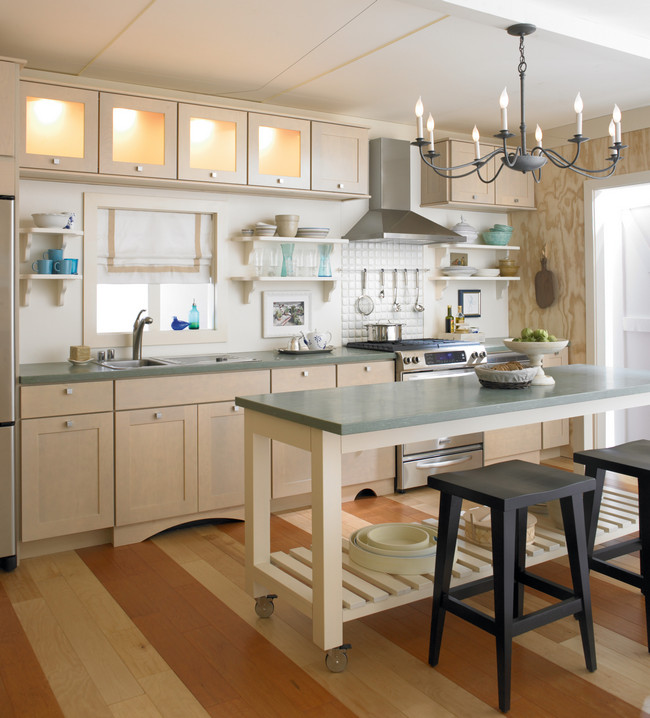 Create a bright and coastal kitchen with cabinetry in Biscotti with Coconut Glaze and warmly lit satina glass doors.
