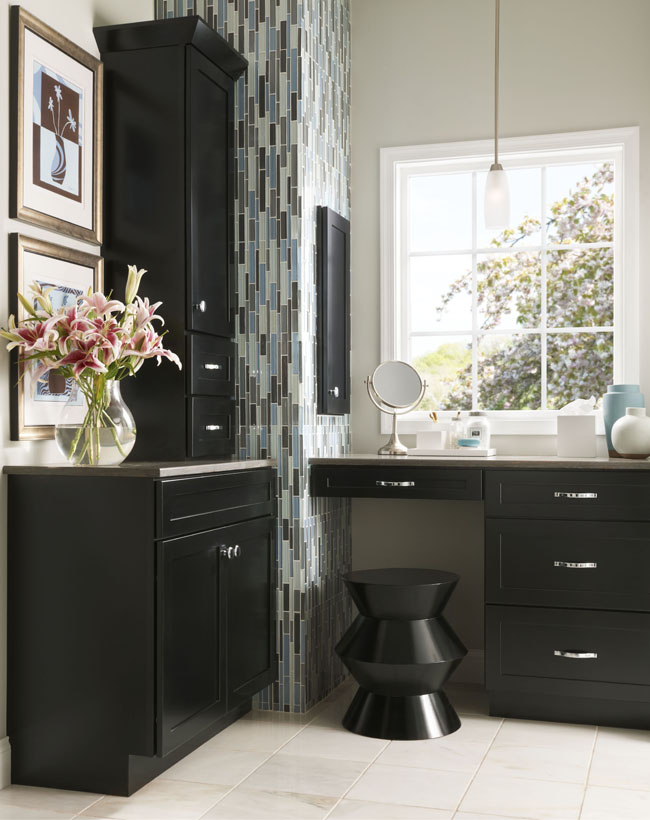 A built-in vanity and cabinets carves out a quiet and relaxing corner for primping in this elegantly simple powder room.