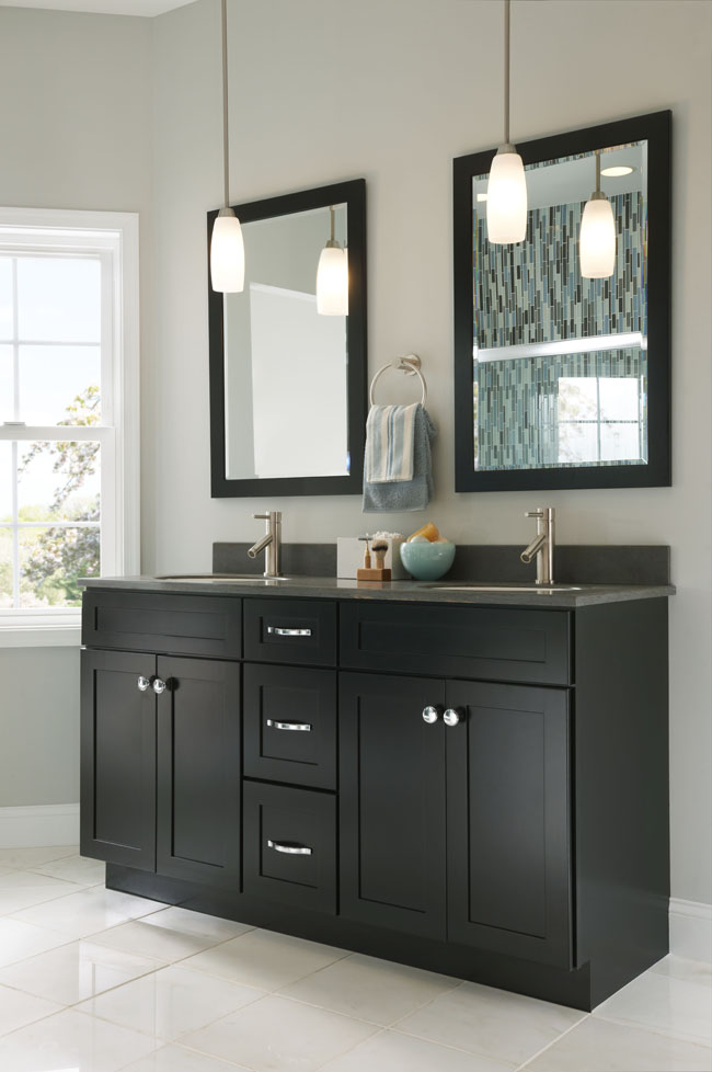 Recessed panel doors mimic the clean lines of a duo of mirrors in this smart his-and-hers bathroom.