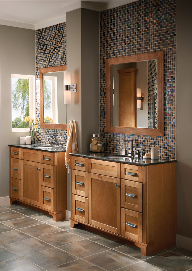 This contemporary bathroom proves that sleek does not equal boring. A stained cabinetry finish warms up expanses of tile and makes an unforgettable statement.