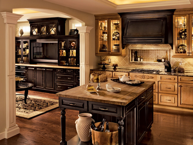 Cabinetry in light Burnished Ginger is accented by an island and mantle in rich Vintage Onyx to create a charming contrast in this transitional kitchen.