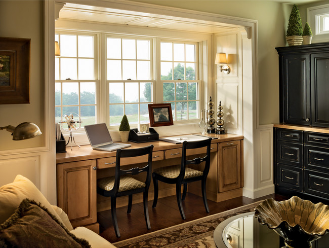 Create useful and attractive furniture with KraftMaid products. A window desk in Burnished Ginger on Maple is just one example.