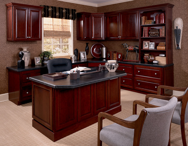 A custom desk, bookcase and upper cabinets in Cabernet gives this home office a polished, pulled together look.