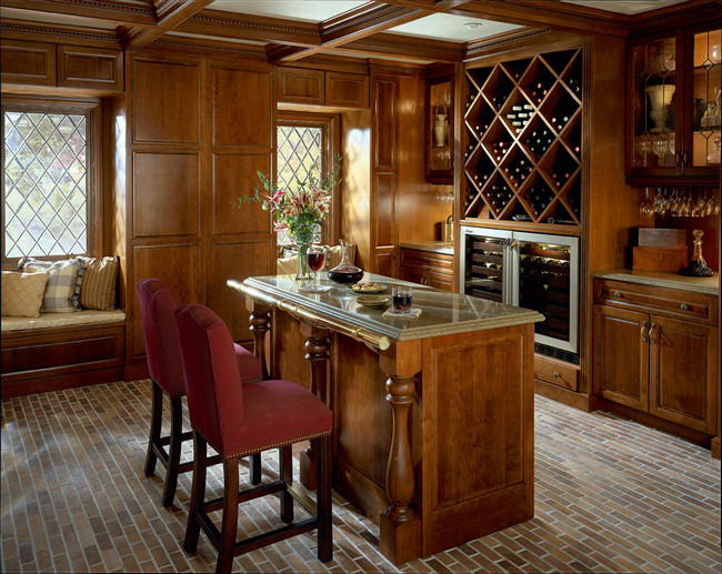 For a truly classic look for this great room, Antique Chocolate with Mocha Glaze on cherry extends from the cabinetry into the custom paneling.