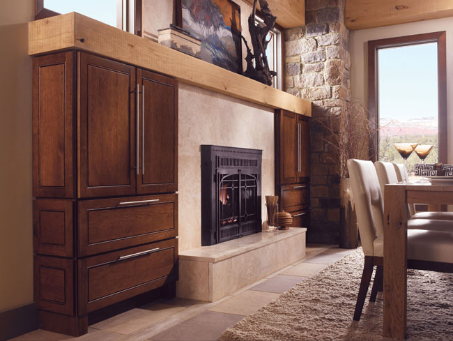 A fireplace flanked by striking armoires provides lots of storage space while creating a bold focal point for this room.