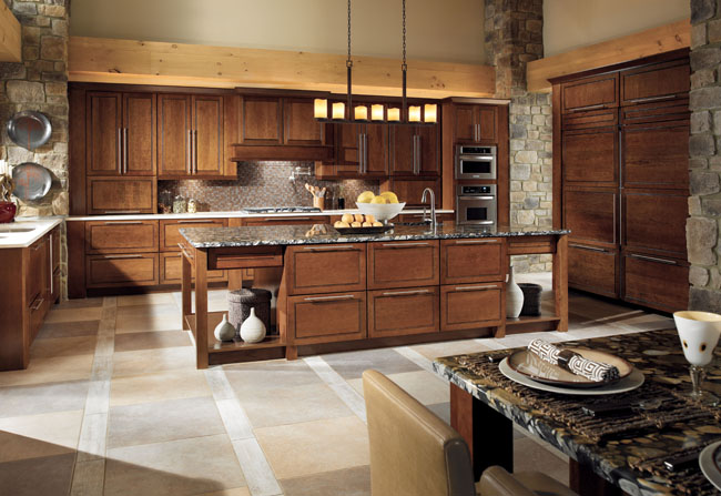 This rustic contemporary kitchen boasts gorgeous cabinetry in Mandolay Cherry Cognac, providing ample but understated storage.  The strong lines of the door style are echoed in the hardware, chandelier, and island footprint.