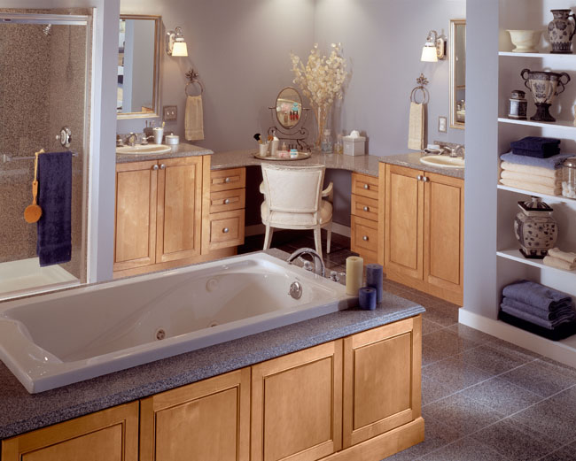 The star of this contemporary master bath is a custom dressing table and double vanities featuring Mandolay in Maple Toffee. The natural wood offers a lovely visual balance to the expanse of tile and porcelain common to luxury baths.