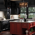 The heavy molded door and dramatic black and red contrast of this kitchen offer a bold statement of heritage.