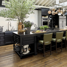 In the House Beautiful 2011 Kitchen of the Year, designed by celebrity chef Tyler Florence, Harrington Maple Square cabinetry in Onyx creates an ample work island and prep area. The dark color grounds the abundant space and makes bright chairs and fresh ingredients pop.