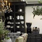 Harrington Maple Square cabinetry in Onyx forms a dramatic butler's pantry for displaying white earthenware in one corner of the House Beautiful 2011 Kitchen of the Year, designed by star chef Tyler Florence.