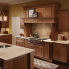 Warm cherry cabinets and unique architectural details add an heirloom texture to this comfortable kitchen.