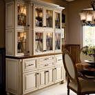 Mullion textured glass and oil rubbed bronze hardware accent this maple hutch in Canvas with Cocoa Glaze and beautifully showcase your serving ware.