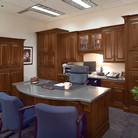 Rich Cherry cabinetry finished in Antique Chocolate with Mocha Glaze sets an impressive tone throughout the executive's office.