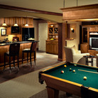 This Spotlight Home was featured in House Beautiful magazine. With a place for games and media systems and a fully stocked bar, this cherry ensemble accommodates the neighborhood cocktail party as easily as it does family movie night.