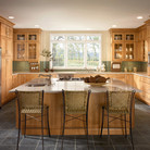 Modern style can be inviting with cabinetry in warm Toffee and an island that begs for company to gather.