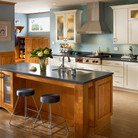 Bringing the sink into the island helps create a fully-functional work triangle—perfect for any chef.