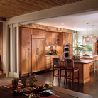 A large open kitchen benefits from dual islands, not just for food preparation, but by giving friends and family a place to gather.