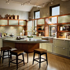 Painted Willow is warmed by a Cinnamon finish and natural light to create a contemporary L-shaped kitchen.