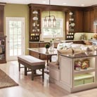 Fox Chase Cherry in Hazel stain and Fox Chase Maple in new Chai paint with Cocoa Glaze pair beautifully to create this warm, welcoming kitchen. Designated spaces for dining, entertaining, relaxing and of course cooking make this room the center of the whole family's life.