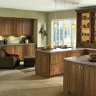 Rustic species and clean doorstyle give this kitchen a comfortable look.