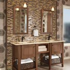 A rich mix of textures distinguishes this striking bath. Start with a console vanity in Putnam Cherry in Husk Suede to get the look of fine furniture; the all-plywood construction delivers long-lasting beauty. Add the Mode Knob in Brushed Bronze, graphic print wallpaper, natural baskets, and a dramatic tile backsplash to complete the ensemble.