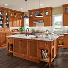 This kitchen features a hutch that provides two kinds of storage: on the top, wedding china on display; hidden in the bottom, the mismatched plastic lids every kitchen secretly contains.  Congnac leather inserts are used at the island cabinet doors in place of the standard wood to add a sense of timelessness.