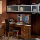 Another view of this dynamic contemporary kitchen demonstrates how to seamlessly tuck in a home office. Melrose Quartersawn Oak in Peppercorn and Toffee finishes maintain the look of the larger room, while drawers and cabinets are repurposed to house office essentials and an organized workstation.