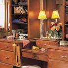 "This bedroom gives new meaning to the term ""walk in closet."" Hanley in Maple Chestnut lends a worldly grace to the bureaus, dressing table, wardrobe, and bench, creating a comfortable, classic space for dinner dressing."