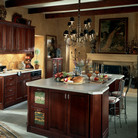 An eclectic kitchen provides perfect storage solutions in deep base cabinets and multi-storage pantries in rich Cabernet.