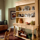 This natural maple hutch gives any casual dining area a fun, country feel with plenty of space to showcase collectibles and arrange drinks or desserts.