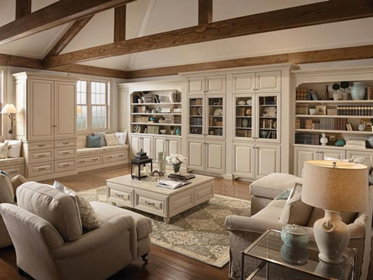 Tall bookcases and drawer units create a graceful wall of storage and form the basis for comfortable window seats with a view. The muted color palette is restful and gives collectibles the attention they deserve.