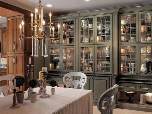 The focal point of this traditional dining room is the gorgeous bank of cabinetry in Richland Maple Square in Sage with Onyx Glaze. But bistro glass doors and internal lighting transfers the spotlight to the homeowner's beloved collections.
