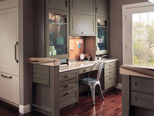 A beautiful duo of Garrison Square Maple in both Sage and Mushroom finishes is the star of this timeless home office. The secret to the high functioning space is the combination of drawers, cabinets, and cubbies, offering the perfect place for every office essential.