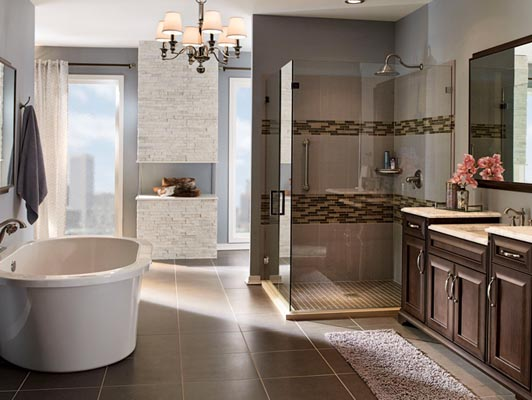 This master bath is truly a private retreat. The furniture-quality vanity in Kendrick Cherry with Saddle Suede finish features unique side accents and feet for a custom, one-of-a-kind feel. Crescent Pull hardware adorns drawers and doors alike.